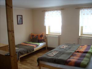 Кровать или кровати в номере Penzion restaurace U Racaku
