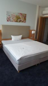 Кровать или кровати в номере Hotel Ambiente