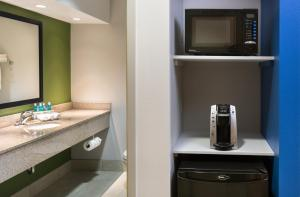 Coffee and tea-making facilities at Holiday Inn Express Cedar Rapids - Collins Road, an IHG Hotel