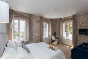 A room at Bifora Heritage Hotel