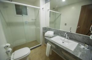 Um banheiro em Casa Nova Hotel