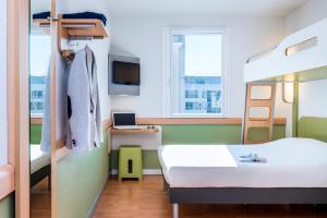 A room at Ibis Budget Clermont Ferrand - Le Brezet - Aeroport