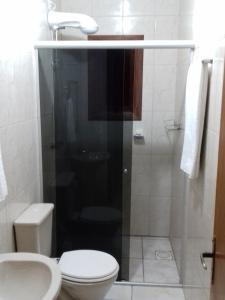 Um banheiro em Residencial Merano