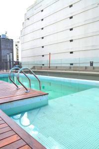 The swimming pool at or close to Patios de San Telmo