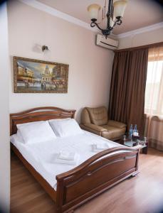 Кровать или кровати в номере Capital Hotel