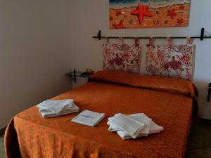 A bed or beds in a room at B&B MareIncantato