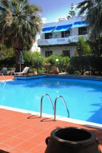 The swimming pool at or near Kalives Apartments