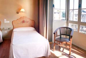 Cama o camas de una habitación en Hotel La Colmena