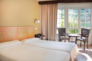 Una habitación en Hotel La Colmena
