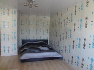 Кровать или кровати в номере Apartment On Lenina 39