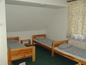 Łóżko lub łóżka w pokoju w obiekcie Hostel Victoria