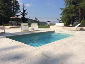 The swimming pool at or near Hotel Nido dell'Aquila