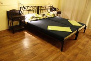 Кровать или кровати в номере Регата Хостел