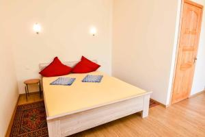 A bed or beds in a room at Pas Bani