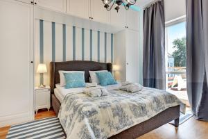 Łóżko lub łóżka w pokoju w obiekcie Lion Apartments - Monte Cassino 42