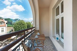 Balkon lub taras w obiekcie Lion Apartments - Monte Cassino 42