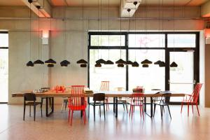 A restaurant or other place to eat at Moxy Munich Airport