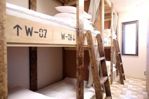 Een stapelbed of stapelbedden in een kamer bij Good Diner Inn Copain