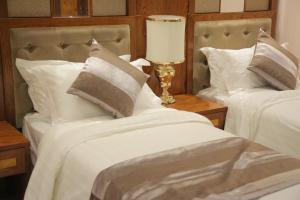 Cama ou camas em um quarto em منازل جدة 2 للوحدات السكنية