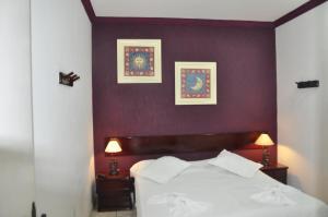 Um quarto em Pousada do Sol de Cabo Frio