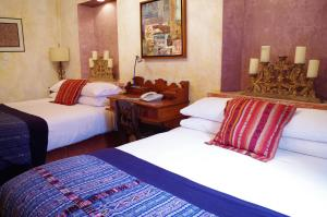 A bed or beds in a room at Meson Panza Verde