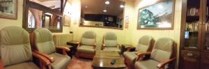 El salón o zona de bar de Hotel Sarao