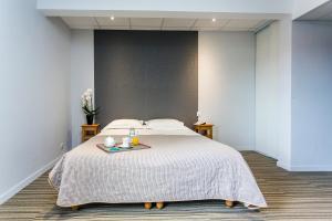 Un ou plusieurs lits dans un hébergement de l'établissement Logis Le Relais