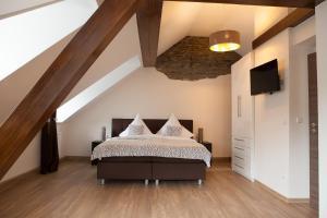 Een bed of bedden in een kamer bij Hotel Ravene