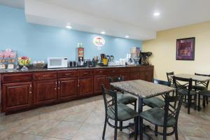 A restaurant or other place to eat at Super 8 by Wyndham Morgantown