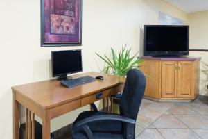A television and/or entertainment center at Super 8 by Wyndham Morgantown