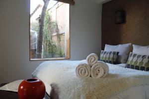 Hotel Boutique Terra Diaguita & Spaにあるベッド