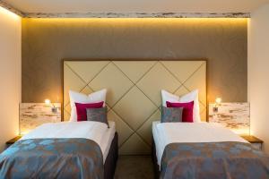Ein Bett oder Betten in einem Zimmer der Unterkunft Allegro