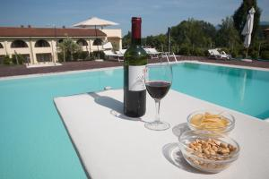 The swimming pool at or near Hotel Carignano