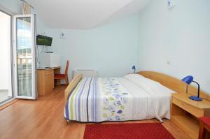 Ένα ή περισσότερα κρεβάτια σε δωμάτιο στο Apartments Villa Lida