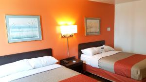 A bed or beds in a room at Motel 6-Wausau, WI