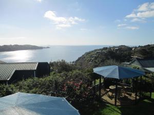 A balcony or terrace at Waiheke Island Tawa Lodge - Adults Only