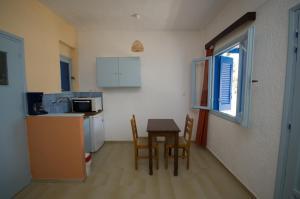 A kitchen or kitchenette at Gialos Studios & Apartments