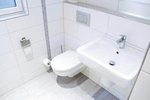 Ein Badezimmer in der Unterkunft Hoofer Apartments