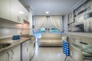A kitchen or kitchenette at Apartamentos Las Brisas