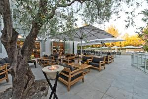 A restaurant or other place to eat at Golden Tulip Sophia Antipolis - Hotel & Spa