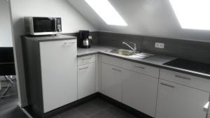 Küche/Küchenzeile in der Unterkunft Ferienwohnung Wesertraum