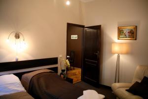 Łóżko lub łóżka w pokoju w obiekcie Apartamenty Astur