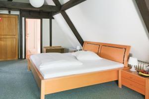 Ein Bett oder Betten in einem Zimmer der Unterkunft Doernersches Haus