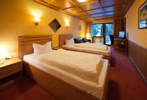 A bed or beds in a room at Atlas Grand Hotel