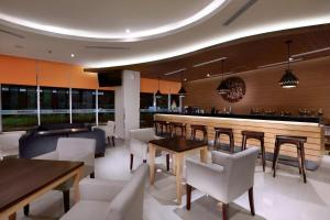 The lounge or bar area at Harper MT Haryono by ASTON