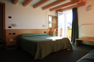 A bed or beds in a room at Albergo Miramonti