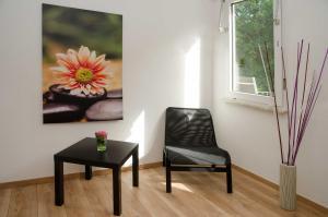 Ein Sitzbereich in der Unterkunft Apart Hotel Paradies