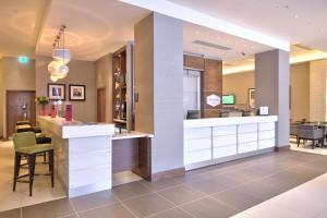 The lobby or reception area at Hampton by Hilton London Croydon