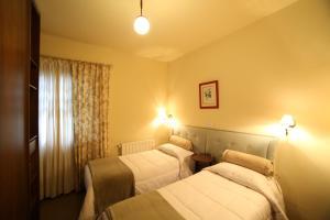 Cama ou camas em um quarto em Europa Hotel