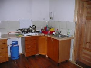 Kuchnia lub aneks kuchenny w obiekcie Mazurska Perła